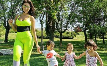 Georgina passeia com os filhos